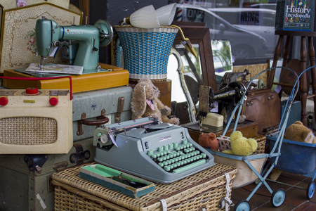 Vintage objects for sale at street market antiques shop Editorial