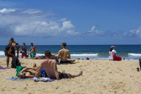 People sunbathe at Australian beach