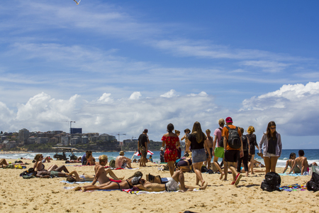 Unidentified people sunbathe at Manly beach Editorial