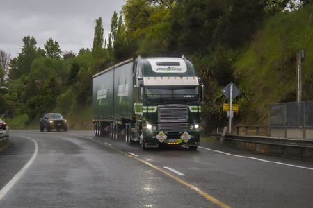 Truck on a wet road on a rainy day