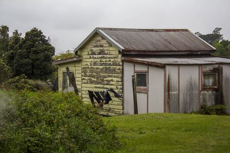 Very old wooden house, with clothes on the clothesline