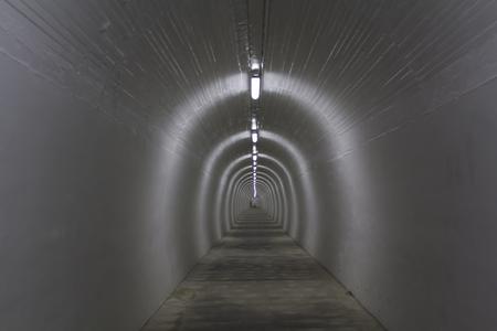 Long white pedestrian tunnel