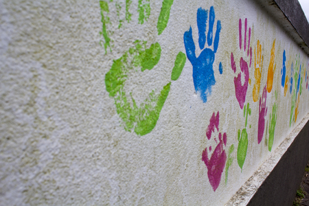 Wall with children hand prints