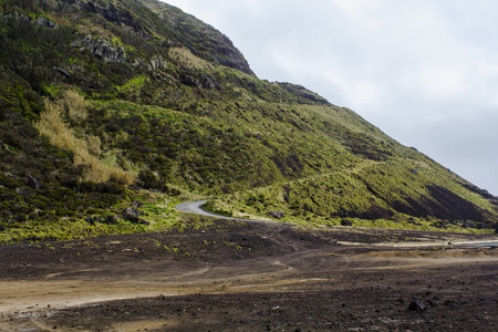 Dangerous road on hill with many curves and inclination in volcanic area