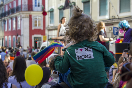 Child with rainbow flag at LGBT Pride Parade Banco de Imagens