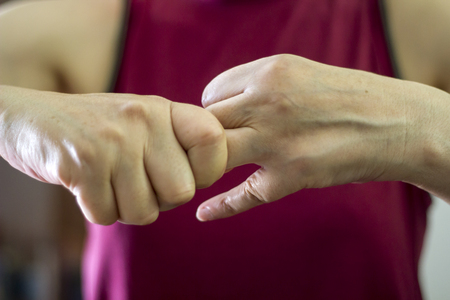 Older woman cracking their knuckles, close up