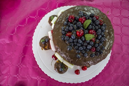 Top view of birthday cake. Chocolate cake with red fruits Reklamní fotografie