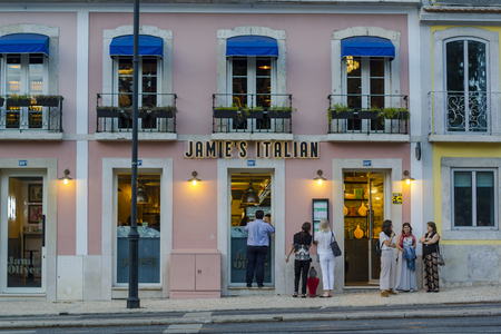 LISBON, PORTUGAL - JUNE 21, 2018: People waiting outside Jamie Oliver italian restaurant in Lisbon