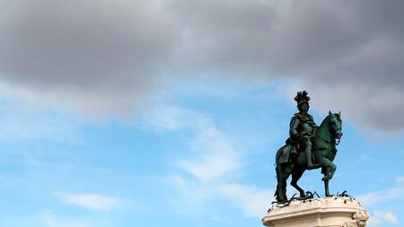 The bronze equestrian statue of Joseph I of Portugal against blue sky