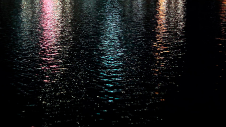 Lights reflect on the water