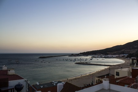 Aerial view of the coastal town of Sesimbra with pier and ship and beach Stok Fotoğraf