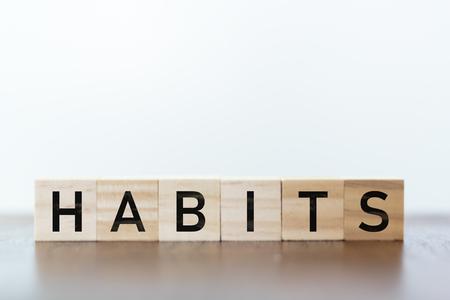 Habits written on wooden cubes Фото со стока