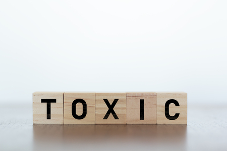 Toxic Word written on wooden cubes. Toxic' is Oxford Dictionaries word of the year, Stock Photo