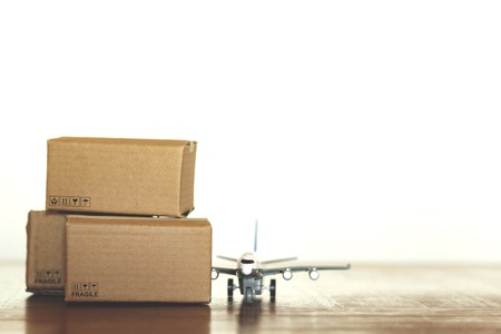 Cartons and airplane with copy space