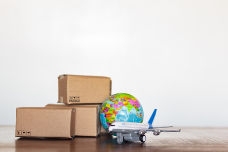 Carts with airplane and earth globe. International delivery and global logistics concept