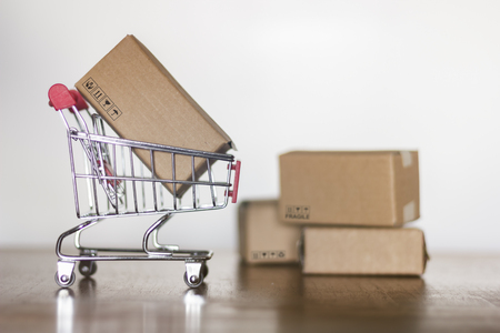 Cartons and trolley. Shopping concept Stock Photo - 115850682