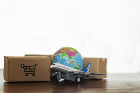 Cartons with airplane and earth globe. Online shopping, International delivery and global logistics concept