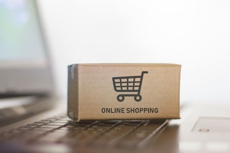 Carton on laptop. Online shopping, e-commerce concept