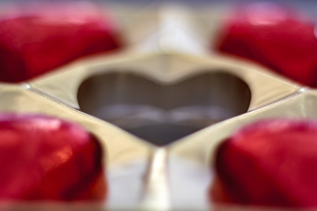 Missing one chocolate heart from box Stock Photo