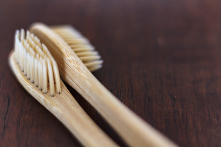 Bamboo toothbrushes on wooden table. Zero waste and Sustainable lifestyle concept