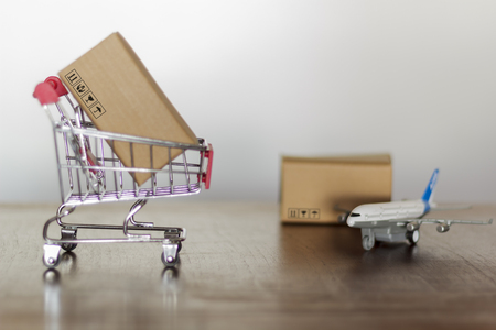 Trolley with carton. Shopping and International shipping concept Standard-Bild