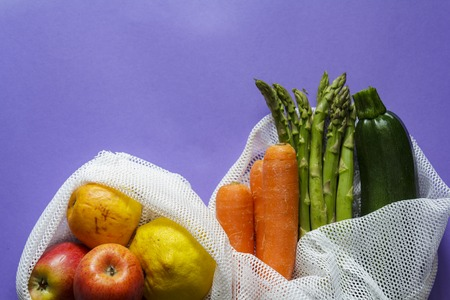 Top view of Fruit and vegetables on reusable bags with copy space