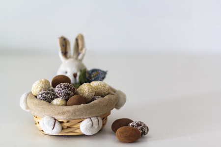 Different Easter Chocolate almond eggs on bunny basket