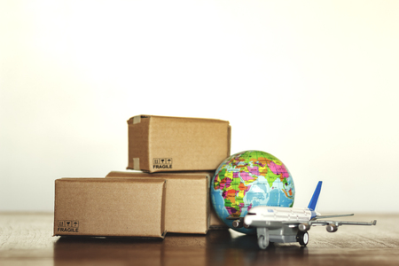 Pile of cartons with airplane and earth globe