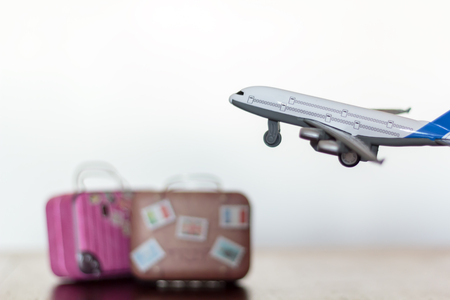 Airplane flying over travel luggage