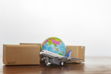 Cardboard boxes with airplane and earth globe