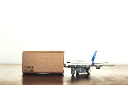 Carton and airplane with copy space