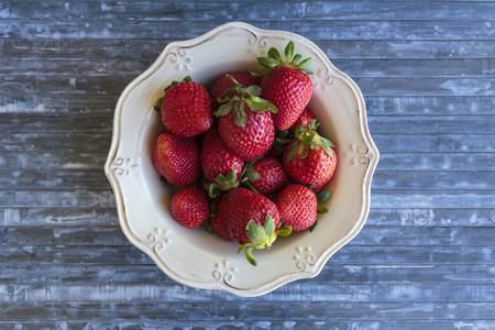 Top view of strawberries in vintage bowl Banco de Imagens