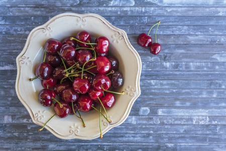 Top view of cherries in vintage bowl with copy space Banco de Imagens