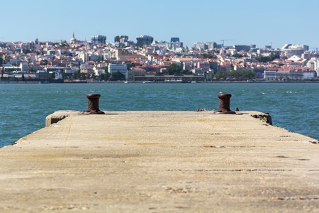 Pier with city on the background Banco de Imagens