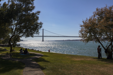 Almada, Portugal: CIRCA May 2019: People relaxing at park on a sunny day