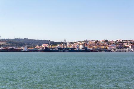 Lisbon, Portugal: CIRCA May 2019: Cargo ship at Port of Lisbon