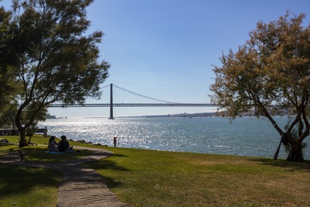 Lisbon, Portugal: CIRCA May 2019: People relaxing at park on a summer day Banco de Imagens