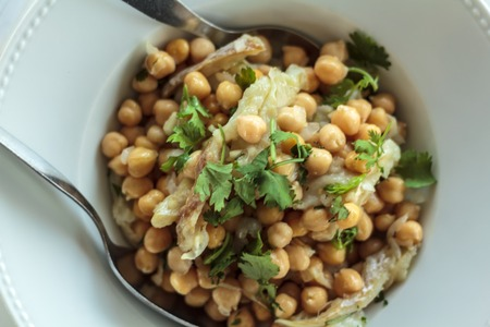 Top view of Grain salad with cod and coriander. Typical portuguese cuisine