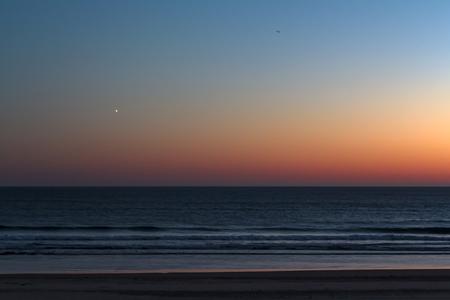 Beach with sunset sky Banco de Imagens