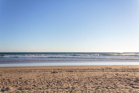 Beach background. Sand, sea and bue sky Banco de Imagens