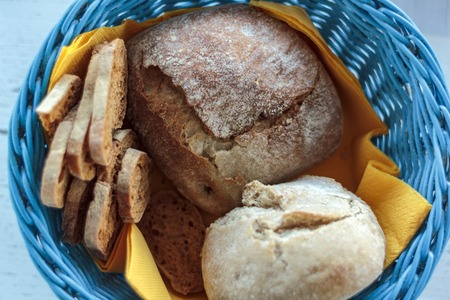Top view of blue basket with bread and toast