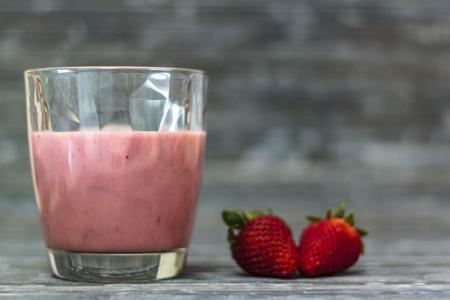 Glass with strawberry milkshake with copy space Banco de Imagens