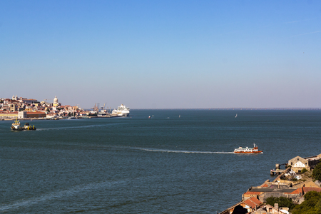 High angle view of ferry boat crossing river from Lisbon city to Lisbon south bay