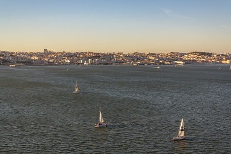 Lisbon, Portugal- CIRCA May 2019: Sailboats at tagus river with city of Lisbon on the background