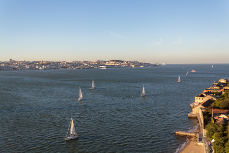 Aerial view of Lisbon and South bay with sailboats on river Tagus