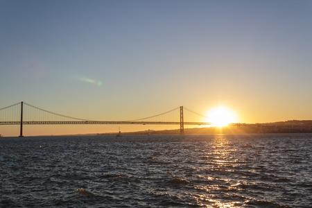 April 25th Bridge and tagus river at sunset