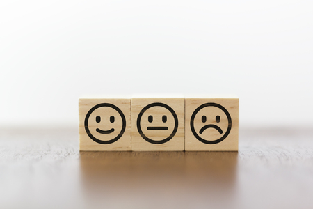 Smiley face, neutral face and sad face. Service rating and costumer satisfaction concept 版權商用圖片