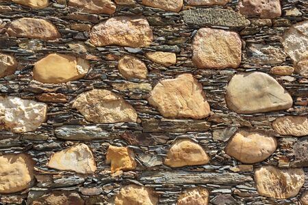 Stone and schist wall. Background, texture
