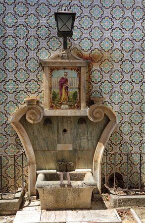 Ancient fountain in Portuguese Village Фото со стока