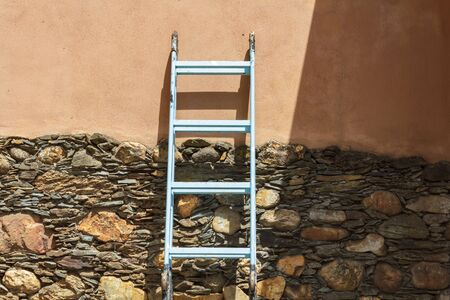 Blue step ladder against the wall
